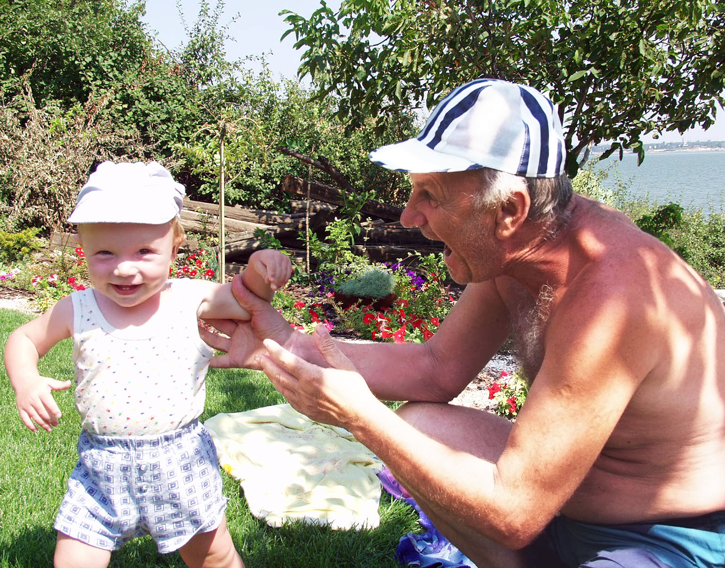 Grandfather and grandson in the garden